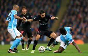 Manchester City's Bacary Sagna (right) and Paris Saint-Germain's Angel Di Maria battle for the ball during the UEFA Champions League Quarter Final, Second Leg match at the Etihad Stadium, Manchester. Nigel French/PA Wire