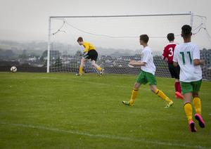 Carniney Youths goalkeeper Daniel McNicholl keeps a close eye on this shot as it veers just wide of the upright, against Donegal Schoolboys in Thursday's u-14 Hughes Insurance Boyle Cup clash at Leafair, Derry. FC04-M2-02