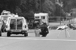 A police photographer at the scene of the 1982 car bomb, in which four soldiers died, in Hyde Park, London, as the prosecution of the Hyde Park bombing suspect John Downey has collapsed.