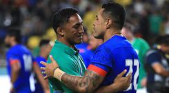 Ireland's Bundee Aki (left) and Samoa's Tusi Pisi after the game during the 2019 Rugby World Cup Pool A match at Fukuoka Hakatanomori Stadium.