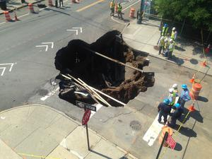 Sinkholes around the world -  This massive sinkhole swallowed an intersection at Brooklyns Sunset Park in New York. Image: New York City Fire Department (FDNY) / Facebook