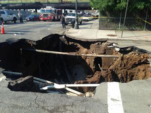 The massive sinkhole swallowed an intersection at Brooklyns Sunset Park in New York. Image: New York City Fire Department (FDNY) / Facebook
