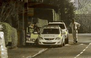 Police officers and forensics at the scene of an incident on Station Road in Greenisland on January 19, 2016 (Photo by Kevin Scott)