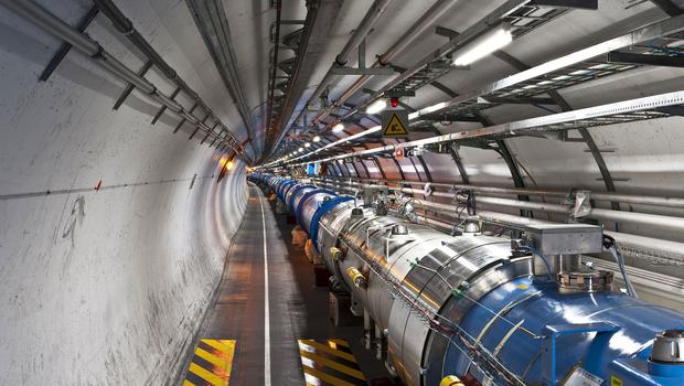 The beam tunnel at the Large Hadron Collider (Maximilien Brice/Cern/PA)
