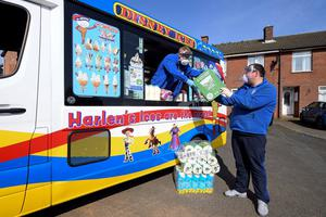 An ice cream van being used to make essential deliveries to local people in need in the lower Oldpark and Shankill Road area of Belfast on Thursday March 26th. Picture By Justin Kernoghan