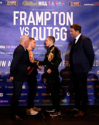 Carl Frampton (centre left) and Scott Quigg (centre right) alongside promoters Barry McGuigan and Eddie Hearn go head to head after a press conference at the Radisson Blu Hotel, Manchester. Simon Cooper/PA Wire.