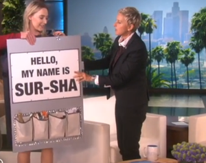 Ellen Degeneres gives Saoirse Ronan a sandwich board to wear with the phonetic spelling of her name