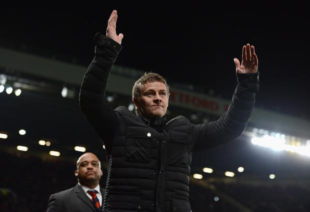 MANCHESTER, ENGLAND - JANUARY 28:  Cardiff City Manager Ole Gunnar Solskjaer salutes the crowd prior to the Barclays Premier League match between Manchester United and Cardiff City at Old Trafford on January 28, 2014 in Manchester, England.  (Photo by Michael Regan/Getty Images)