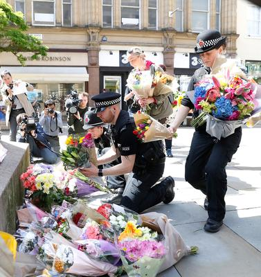 Flowers are left in St Ann's Square, Manchester, the day after a suicide bomber killed 22 people, including children, as an explosion tore through fans leaving a pop concert in Manchester. PRESS ASSOCIATION Photo. Picture date: Tuesday May 23, 2017. See PA story POLICE Explosion. Photo credit should read: Martin Rickett/PA Wire