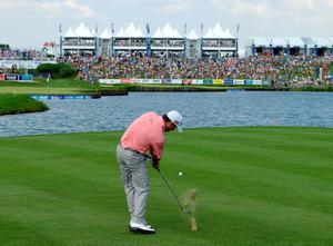 PARIS, FRANCE - JULY 07:  Graeme McDowell of Northern Ireland plays into the 15th green during the final round of the Alstom Open de France at Le Golf National on July 7, 2013 in Paris, France.  (Photo by Richard Heathcote/Getty Images)