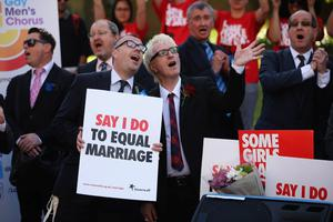 LONDON, ENGLAND - JUNE 03:  Proponents of same sex marriage sing during a vigil outside the Houses of Parliament on June 3, 2013 in London, England.  A government bill allowing same sex marriage in England and Wales was passed in the House of Commons last month, despite the opposition of 133 Conservative MP's. The bill is currently being debated in the House of Lords.  (Photo by Dan Kitwood/Getty Images)