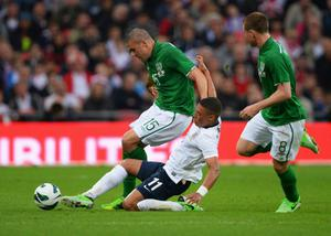 LONDON, ENGLAND - MAY 29:  Alex Oxlade-Chamberlain of England tackles Jon Walters of the Republic of Ireland during the International Friendly match between England and the Republic of Ireland at Wembley Stadium on May 29, 2013 in London, England.  (Photo by Mike Hewitt/Getty Images)