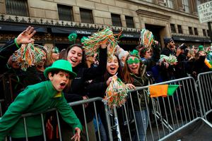 NEW YORK, NY - MARCH 17: People cheer as the during the annual St. Patrick's Day parade, one of the largest and oldest in the world on March 17, 2016 in New York City. Now that a ban on openly gay groups has been dropped, New York Mayor Bill de Blasio is attending the parade for the first time since he became mayor in 2014. The parade goes up Fifth Avenue ending at East 79th Street and will draw an estimated 2 million spectators along its 35-block stretch.  (Photo by Spencer Platt/Getty Images)