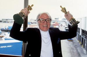 File photo dated 14/04/83 of Richard Attenborough arriving at Heathrow Airport with the Oscars he won for his film Gandhi as Lord Attenborough has died aged 90, the BBC reported tonight. PRESS ASSOCIATION Photo. Issue date: Sunday August 24, 2014. See PA story DEATH Attenborough. Photo credit should read: PA Wire