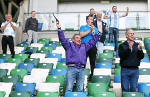 Press Eye - Belfast - Northern Ireland - 31st July 2020 -   Sadler's Peaky Blinder Irish Cup Final at the National Football Stadium at Windsor Park - Ballymena United FC v Glentoran FC.   Ballymena fans celebrate after they score to make it 1-1.  250 fans for each team were permitted into the ground with social distancing conditions in relation to COVID-19.  Photo by Jonathan Porter Press Eye.