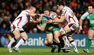 Ulster's Callum Black, Franco van der Merwe and Clive Ross tackle Tom McCartney of Connacht. INPHO/James Crombie.