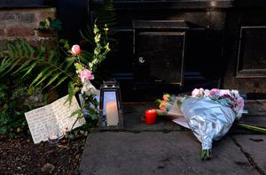Flowers and candles left in memory of George Michael outside his London home, as the pop superstar has died at the age of 53 from suspected heart failure.