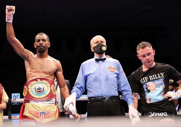 Jamel Herring (left) has his hand raised after victory over Carl Frampton (right), whose career is at an end.