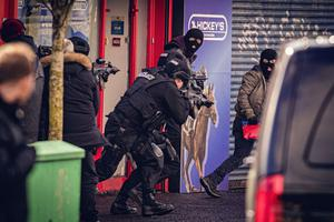 Armed police chase men wearing balaclavas from a bookmakers during Line of Duty filming on Cavehill Road and Sunningdale Park on March 15th 2020 (Photo by Kevin Scott for Belfast Telegraph)