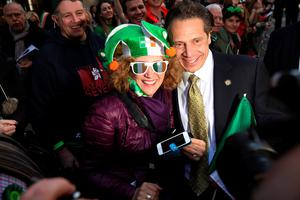 NEW YORK, NY - MARCH 17:  New York governor Andrew Cuomo poses for a picture while  marching in the annual St. Patrick's Day parade, one of the largest and oldest in the world on March 17, 2016 in New York City. Now that a ban on openly gay groups has been dropped, Mayor de Blasio is attending the parade for the first time since he became mayor in 2014. The parade goes up Fifth Avenue ending at East 79th Street and will draw an estimated 2 million spectators along its 35-block stretch.  (Photo by Spencer Platt/Getty Images)