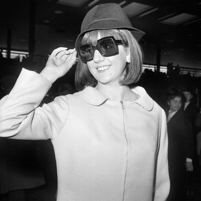 Cilla Black at London Airport where she was  leaving for New York to appear on the Ed Sullivan Show in 1965. PA Wire.