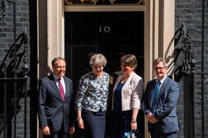 Prime Minister Theresa May greets DUP leader Arlene Foster, DUP deputy leader Nigel Dodds and DUP MP Sir Jeffrey Donaldson outside 10 Downing Street in London ahead of talks aimed at finalising a deal to prop up the minority Conservative Government. Dominic Lipinski/PA Wire