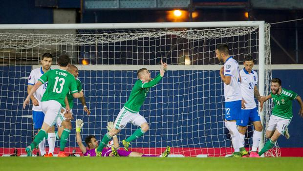 Northern Ireland's Steven Davis (centre) celebrates scoring his side's first goal of the game during the UEFA European Championship Qualifying match at Windsor Park, Belfast. PRESS ASSOCIATION Photo. Picture date: Thursday October 8, 2015. See PA story SOCCER N Ireland. Photo credit should read: Liam McBurney/PA Wire.