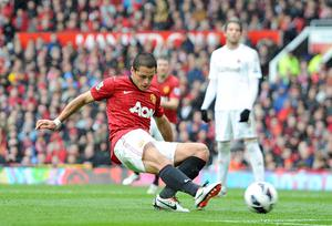 Manchester United's Javier Hernandez scores their first goal of the game during the Barclays Premier League match at Old Trafford, Manchester. PRESS ASSOCIATION Photo. Picture date Sunday May 12, 2013. See PA story SOCCER Man Utd. Photo credit should read: Martin Rickett/PA Wire. RESTRICTIONS: Editorial use only. Maximum 45 images during a match. No video emulation or promotion as 'live'. No use in games, competitions, merchandise, betting or single club/player services. No use with unofficial audio, video, data, fixtures or club/league logos.