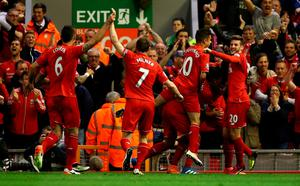 Liverpool players celebrate following Divock Origi's opening goal during the Barclays Premier League match between Liverpool and Everton at Anfield, April 20, 2016, Liverpool, England  (Photo by Clive Brunskill/Getty Images)