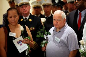 NEW YORK, NY - SEPTEMBER 08:  Firefighters and family attend a ceremony at the Fire Department of New York headquarters where names were added to a memorial wall for deaths related to World Trade Center illnesses on September 8, 2015 in New York City. A total of 21 names were added to the memorial which was unveiled in September 2011 and already lists the names of 89 FDNY members who died of illnesses related to their work at the World Trade Center site during and after the 9/11 attacks.  (Photo by Spencer Platt/Getty Images)