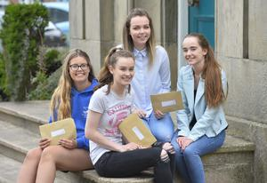 A Level results at Banbridge Academy in Co Down.  Pictured are A-s students Ellie Large,Rebekah Dougan and Lauren Ferguson with Olivia Knox. Picture Mark Marlow