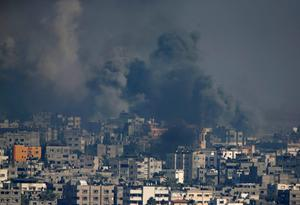 Smoke rises after an Israeli shelling at the Shijaiyah neighborhood in Gaza City, Gaza Strip, Monday, July 21, 2014. (AP Photo/Adel Hana)