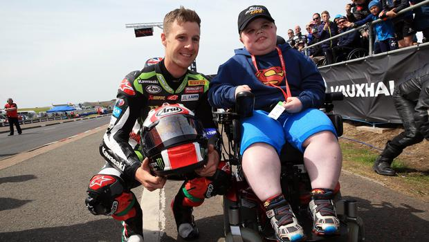 PACEMAKER BELFAST  19/05/2018 North West 200 2018 World Superbike Champion Jonathan Rea on a parade lap of the course during this years North West 200. pictured with fanJosh McClean (13) Photo Stephen Davison/Pacemaker Press