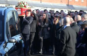 Funeral of 23-year-old Jamie Burns who died last Sunday as a result of taking ecstasy on a night out.  Mr Burns' coffin leaves his home on the York Road in north Belfast followed by family and friends.  Picture by Jonathan Porter/Press Eye