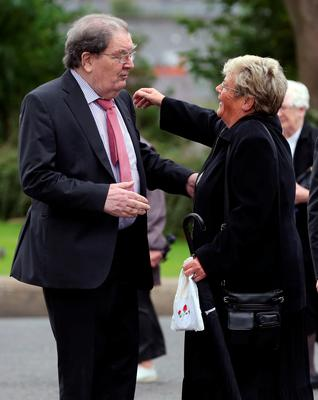 John Hume (left) hugs Kay Duddy, sister of Bloody Sunday victim Jackie Duddy, before the funeral of Dr Edward Daly at St Eugene's Cathedral in Londonderry. PRESS ASSOCIATION Photo. Picture date: Thursday August 11, 2016. The former Bishop of Derry who came to the aid of a dying civil rights protester on Bloody Sunday and waved a white handkerchief in an enduring image of the Troubles died on Monday aged 82. See PA story ULSTER Daly. Photo credit should read: Niall Carson/PA Wire