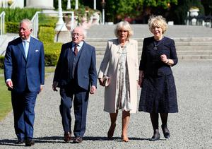Ireland's President, Michael D Higgins (2nd L) and his wife Sabina (W) walk with Britain's Prince Charles, Prince of Wales (L) and his wife Britain's Camilla, Duchess of Cornwall in the gardens at Aras an Uachtarain, the official residence of the President, in Pheonix Park, Dublin, on May 10, 2017. AFP/Getty Images