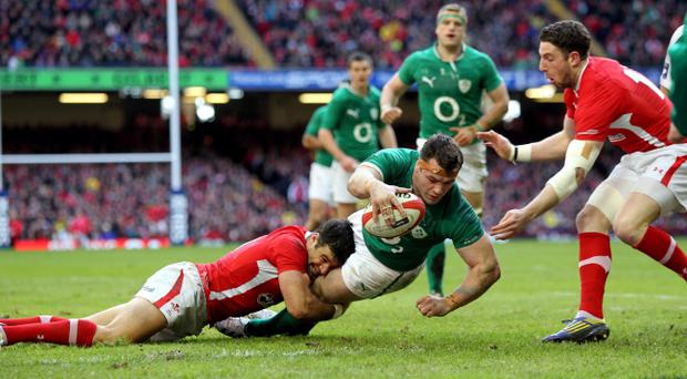 Ireland's Cian Healy beats the tackle Wales' Mike Phillips to scores Ireland's second try during the RBS 6 Nations match at the Millennium Stadium, Cardiff