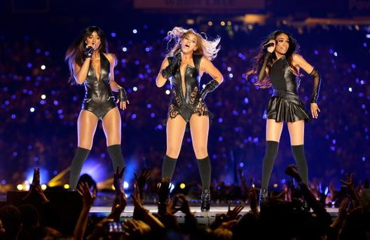 NEW ORLEANS, LA - FEBRUARY 03: (L-R) Singers Kelly Rowland, Beyonce and Michelle Williams perform during the Pepsi Super Bowl XLVII Halftime Show at the Mercedes-Benz Superdome on February 3, 2013 in New Orleans, Louisiana. (Photo by Ezra Shaw/Getty Images)