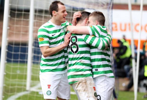 Celtic's James Forrest celebrates scoring the second goal with Anthony Stokes and Gary Hooper during the William Hill Scottish Cup, Fifth Round match at Starks Park, Raith