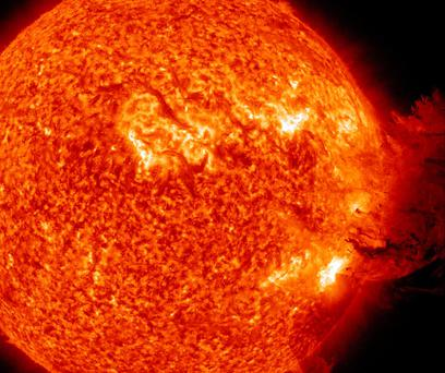 A solar large flare erupts off the sun
