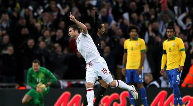 England's Frank Lampard celebrates scoring his side's second goal of the game during the International Friendly at Wembley Stadium