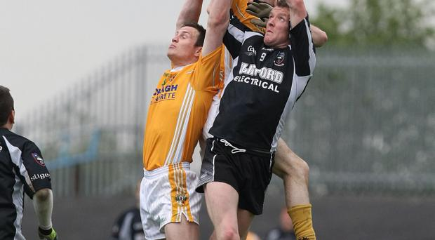 Antrim's Michael McCann's aerial ability can sustain his team's drive for promotion in the league *** Local Caption *** Antrim's Michael McCann's aerial ability can sustain his team's drive for promotion in the league
