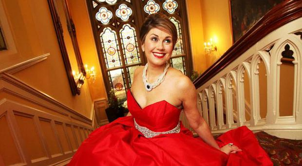 Lady in red: Sarah Travers at the Culloden Hotel in a dress by designer MaryRose McGrath