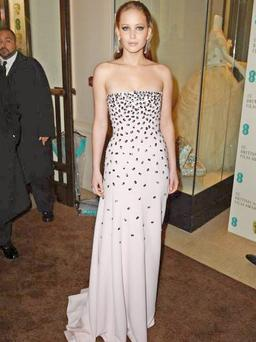 Hit: Jennifer Lawrence Wet-look hair was a cunning ploy on a wash-out of a night. Hollywood's most normal woman was in pink Dior, with mirrored beads – she'll be hoping it doesn't fall apart, as it did at the Emmys