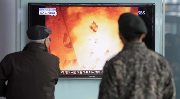 People watch a television broadcast reporting the North Korea's nuclear test at the Seoul Railway station on February 12, 2013 in Seoul, South Korea