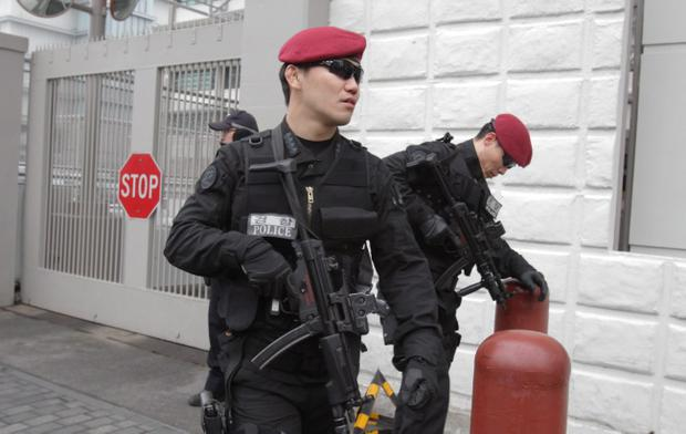 SEOUL, SOUTH KOREA - FEBRUARY 12: Special metropolitan police patrol at the U.S. embassy on February 12, 2013 in Seoul, South Korea. North Korea confirmed it had successfully carried out an underground nuclear test, as a shallow earthquake with a magnitude of 4.9 was detected by several international monitoring agencies. South Korea and Japan both assembled an emergency meeting of their respective national security teams after the incident. (Photo by Chung Sung-Jun/Getty Images)
