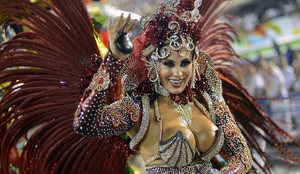 A reveler of Uniao da Ilhia samba school performs during the first night of Carnival parade at the Sambadrome in Rio de Janeiro on February 11, 2013.