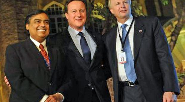 David Cameron with BP's CEO Bob Dudley, right, and Mukesh Ambani, India's richest man