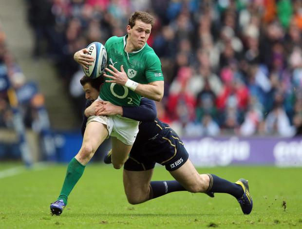 Ireland's Craig Gilroy is tackled by Tim Visser