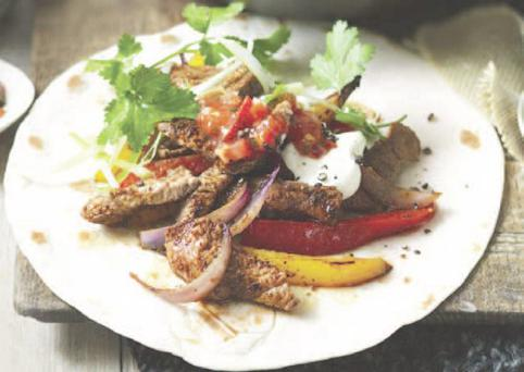 Lamb fajitas served with chillied peppers, avocado and sour cream